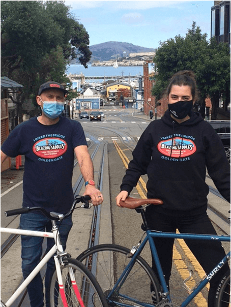 Weronika and Mikey standing with their bikes on Hyde Street, San Francisco
